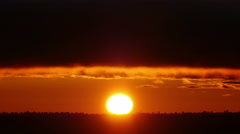 4K Red Sun, Red sun rises over the horizon - stock footage