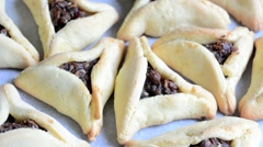 Purim Jewish Holiday food - Hamentashen, Ozen Haman Stock Footage