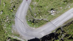 Directly above shot of hikers walking on mountain road - stock footage