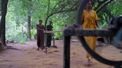 Indian women make rope out of coconut fibers at an outdoor factory Stock Footage