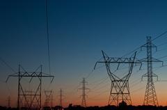 Electrical Towers at Sunset Stock Photos