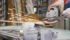 Grinding metal with an angle grinder close up 4k Stock Footage