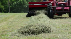 A red tractor bails hay on a farm, generic HD farming - stock footage