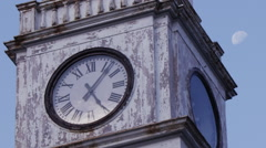 Clock tower with moon, six minutes past five o'clock - stock footage