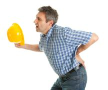 Worker suffering from pain in the back Stock Photos