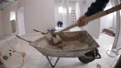 Wheelbarrow full of cement Stock Footage