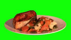 Grilled trout and stewed vegetables on plate Stock Footage