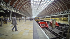 Commuters and tourists at Paddington Station in London City Stock Footage