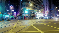Busy street intersection with bright lights timelapse Stock Footage