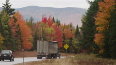 Trucks driving on a New England highway in autumn, RED SCARLET 4K Stock Footage