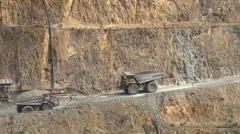 Dump trucks, Martha open cast gold mine, Waihi, New Zealand Stock Footage