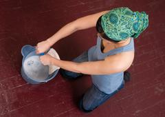 Blue Collar Worker Maid Doing Cleaning Chores Scrubbing Floor Stock Photos