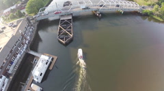 Boat chase under bridge, 1080p HD Stock Footage