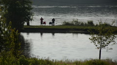 Wide shot of two men fishing at the Hoover Reservoir in Westerville, Ohio/USA Stock Footage