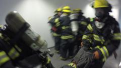 Stock Video Footage of Firefighters search and find casualties in a building full of smoke