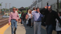 Commuters exit and board a Metra train Stock Footage