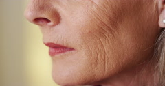 Elderly woman face wringkles closeup Stock Footage