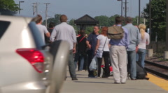 Metra commuters wait for a train during the afternoon rush, 1080p HD Stock Footage