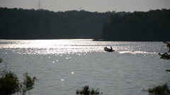 A small boat rides across the Hoover Reservoir in Westerville, Ohio/USA Stock Footage