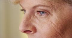 Beautiful mature woman face eyes wringkles closeup Stock Footage