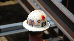 Closeup of a steelworker's hard hat Stock Footage