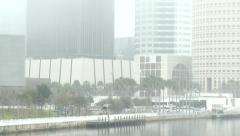 Tilt down of the city of Tampa in the fog to Curtis Hixon Park Stock Footage