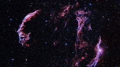 The review of the reddish Crab Nebula which hid behind a set of stars - stock footage