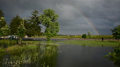 A rainbow shines in a flooded park after flooding at the Hoover Dam and Stock Footage