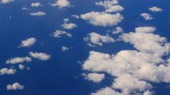 Airplane Window View, Above Clouds, Flying Stock Footage