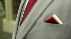 Groom's Grey Tux Tie Pocket Square Rack Focus White Red Stock Footage