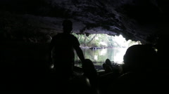 Tourists cave tube on the Caves Branch River in Belize Stock Footage
