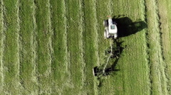Aerial shot of tractor harvesting hay on farm - stock footage