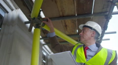 4K Engineer or architect conducting an inspection on construction site - stock footage