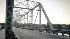 Pedestrians and cars cross a bridge, timelapse Stock Footage