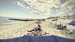 Unidentified people sunbath on the beach, timelapse Stock Footage