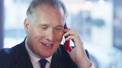4K Cheerful businessman having a phone conversation on mobile phone Stock Footage