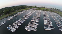Aerial steadicam of Compo Beach marina Stock Footage