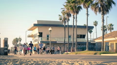 People walk the Huntington Beach boardwalk, timelapse Stock Footage