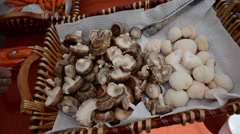 Shiitake and Lion's Mane mushrooms in basket at a farmers market, 1080p Stock Footage