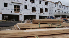 Stock Video Footage of Jib shot of new townhome construction site