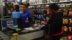 A Best Buy cashier rings up a customer during Black Friday weekend Stock Footage