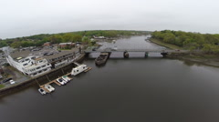 Aerial over small bridge, wide shot Stock Footage