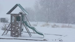 An empty playground in a winter blizzard Stock Footage