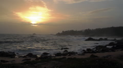 South India beach sunset on incoming tide, 1080p HD Stock Footage