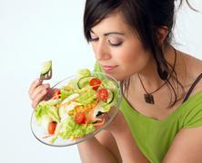 Healthy Eating Woman Enjoys Raw Food Fresh Green Salad Stock Photos