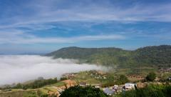 Fade out of fog at mountains park with blue sky with downward movement. - stock footage