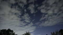 Clouds fly over a fall blue sky timelapse Stock Footage