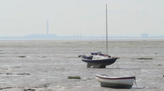 Sailboats at low tide on Leigh-on-Sea, Essex, United Kingdom Stock Footage