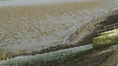 Sea wall drainage on Canvey Island, Essex, United Kingdom Stock Footage