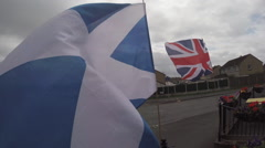 Scottish Flag waving in the wind next to a British Flag Stock Footage